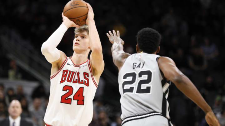 Dec 15, 2018; San Antonio, TX, USA; Chicago Bulls power forward Lauri Markkanen (24) shoots the ball over San Antonio Spurs small forward Rudy Gay (22) during the first half at AT&T Center. (Soobum Im-USA TODAY Sports)