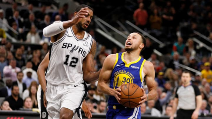 Mar 18, 2019; San Antonio, TX, USA; Golden State Warriors point guard Stephen Curry (30) drives to the basket as San Antonio Spurs power forward LaMarcus Aldridge (12) defends during the second half at AT&T Center. Mandatory Credit: Soobum Im-USA TODAY Sports