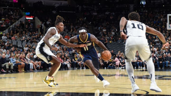 Oct 13, 2019; San Antonio, TX, USA; New Orleans Pelicans guard Jrue Holiday (11) dribbles in against San Antonio Spurs guards Lonnie Walker IV (1) and DeMar DeRozan (10) at the AT&T Center. Mandatory Credit: Daniel Dunn-USA TODAY Sports