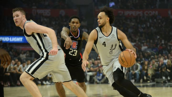 October 31, 2019; Los Angeles, CA, USA; San Antonio Spurs guard Derrick White (4) moves the ball as center Jakob Poeltl (25) provides coverage against Los Angeles Clippers guard Lou Williams (23) during the first half at Staples Center. Mandatory Credit: Gary A. Vasquez-USA TODAY Sports