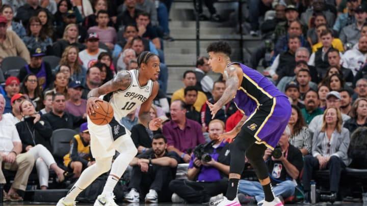 Nov 3, 2019; San Antonio, TX, USA; San Antonio Spurs forward DeMar DeRozan (10) dribbles in front of Los Angeles Lakers forward Kyle Kuzma (0) during the second half at the AT&T Center. Mandatory Credit: Daniel Dunn-USA TODAY Sports