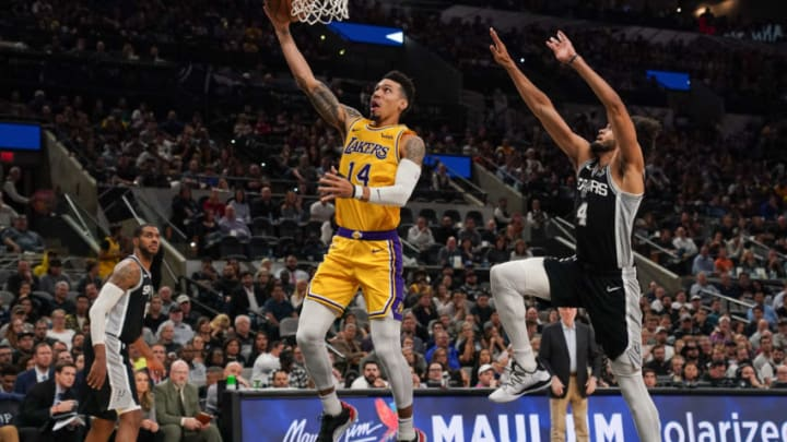Nov 25, 2019; San Antonio, TX, USA; Los Angeles Lakers guard Danny Green (14) shoots in front of San Antonio Spurs guard Derrick White (4) in the second half of the game at the AT&T Center. Mandatory Credit: Daniel Dunn-USA TODAY Sports