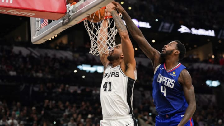 Nov 29, 2019; San Antonio, TX, USA; San Antonio Spurs forward Trey Lyles (41) dunks against LA Clippers forward JaMychal Green (4) during the first half at the AT&T Center. Mandatory Credit: Daniel Dunn-USA TODAY Sports