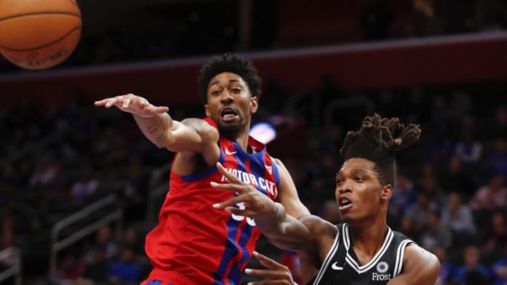 Dec 1, 2019; Detroit, MI, USA; San Antonio Spurs guard Lonnie Walker IV (1) passes the ball against Detroit Pistons forward Christian Wood (35) during the fourth quarter at Little Caesars Arena. (Raj Mehta-USA TODAY Sports)