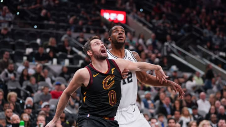 Dec 12, 2019; San Antonio, TX, USA; Cleveland Cavaliers forward Kevin Love (0) and San Antonio Spurs center LaMarcus Aldridge (12) battle for position in the second half at the AT&T Center. Mandatory Credit: Daniel Dunn-USA TODAY Sports