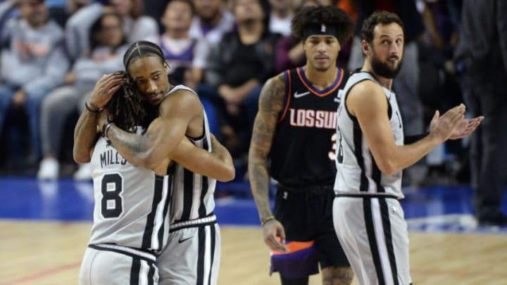 Dec 14, 2019; Mexico City, MEX; San Antonio Spurs guards DeMar DeRozan (10) and Patty Mills (8) embrace after defeating the Phoenix Suns in overtime at Mexico City Arena. Mandatory Credit: Orlando Ramirez-USA TODAY Sports
