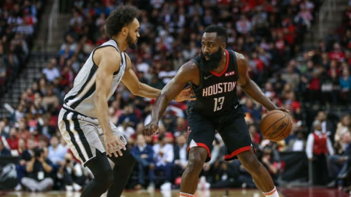 Dec 16, 2019; Houston, TX, USA; Houston Rockets guard James Harden (13) dribbles and San Antonio Spurs guard Derrick White (4) defends during the game at Toyota Center. Mandatory Credit: Troy Taormina-USA TODAY Sports