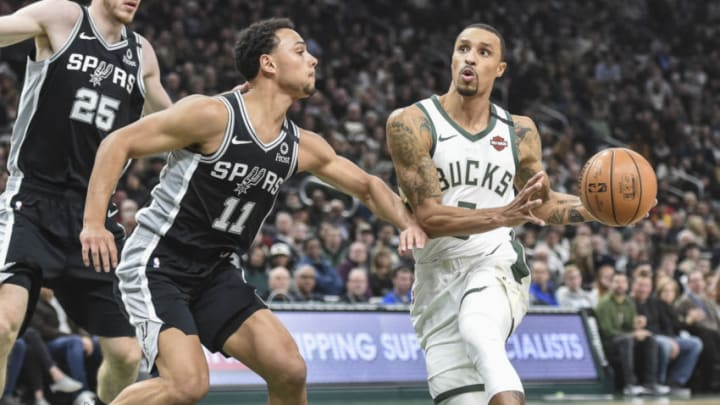 Jan 4, 2020; Milwaukee, Wisconsin, USA; Milwaukee Bucks guard George Hill (3) looks for a shot against San Antonio Spurs guard Bryn Forbes (11) in the second quarter at Fiserv Forum. Mandatory Credit: Benny Sieu-USA TODAY Sports