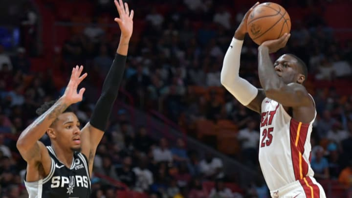 Jan 15, 2020; Miami, Florida, USA; Miami Heat guard Kendrick Nunn (25) makes a three point basket over San Antonio Spurs guard Dejounte Murray (5) during the first half at American Airlines Arena. Mandatory Credit: Steve Mitchell-USA TODAY Sports
