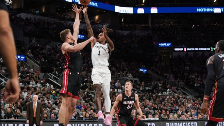 Jan 19, 2020; San Antonio, Texas, USA; San Antonio Spurs guard Lonnie Walker IV (1) shoots over Miami Heat forward Meyers Leonard (0) in the first half at the AT&T Center. (Daniel Dunn-USA TODAY Sports)