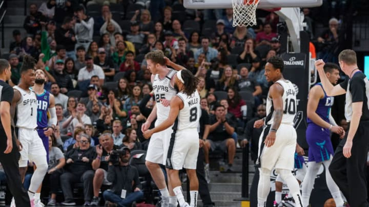 Feb 1, 2020; San Antonio, Texas, USA; San Antonio Spurs guard Patty Mills (8) celebrates a shot by center Jakob Poeltl (25) in the second half against the Charlotte Hornets at the AT&T Center. Mandatory Credit: Daniel Dunn-USA TODAY Sports
