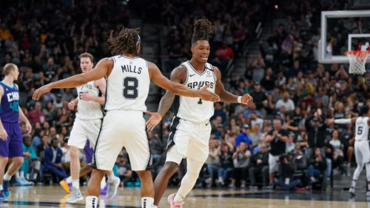 Feb 1, 2020; San Antonio, Texas, USA; San Antonio Spurs guard Patty Mills (8) and guard Lonnie Walker IV (1) celebrate a score in the second half against the Charlotte Hornets at the AT&T Center. Mandatory Credit: Daniel Dunn-USA TODAY Sports