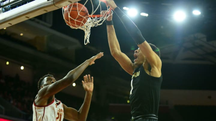 February 1, 2020; Los Angeles, California, USA; Colorado Buffaloes guard Tyler Bey (1) dunks for a basket against Southern California Trojans forward Onyeka Okongwu (21) during the second half at Galen Center. Each of these players should be on the San Antonio Spurs' radar in the 2020 NBA Draft. Gary A. Vasquez-USA TODAY Sports