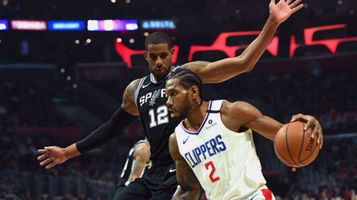 Feb 3, 2020; Los Angeles, California, USA; Los Angeles Clippers forward Kawhi Leonard (2) drives to the basket against San Antonio Spurs forward LaMarcus Aldridge (12) in the first half at Staples Center. Mandatory Credit: Jayne Kamin-Oncea-USA TODAY Sports