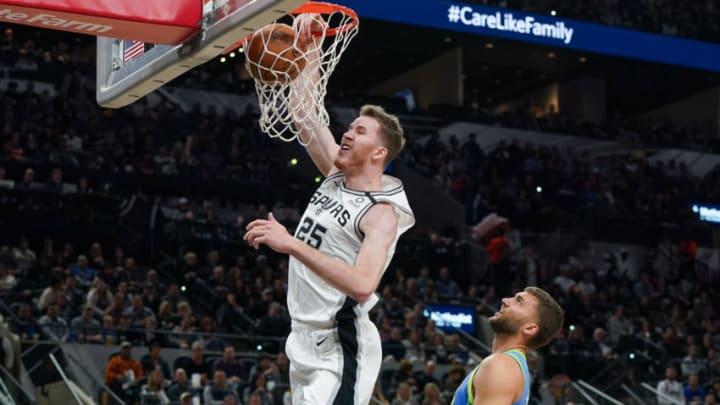 Feb 26, 2020; San Antonio, Texas, USA; San Antonio Spurs center Jakob Poeltl (25) dunks over Dallas Mavericks forward Maxi Kleber (42) in the first half at the AT&T Center. Mandatory Credit: Daniel Dunn-USA TODAY Sports