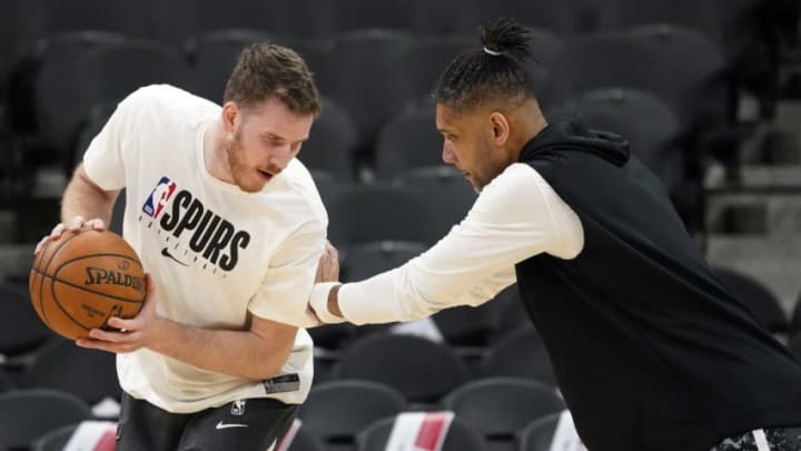 Feb 29, 2020; San Antonio, Texas, USA; San Antonio Spurs center Jakob Poeltl (25) warms up as assistant coach Tim Duncan defends prior to the game against the Orlando Magic X in the first half at AT&T Center. Mandatory Credit: Scott Wachter-USA TODAY Sports