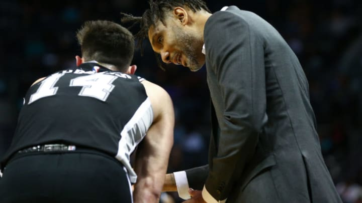 Mar 3, 2020; Charlotte, North Carolina, USA; San Antonio Spurs acting head coach Tim Duncan talks with forward Drew Eubanks (14) during the second half against the Charlotte Hornets at Spectrum Center. Mandatory Credit: Jeremy Brevard-USA TODAY Sports
