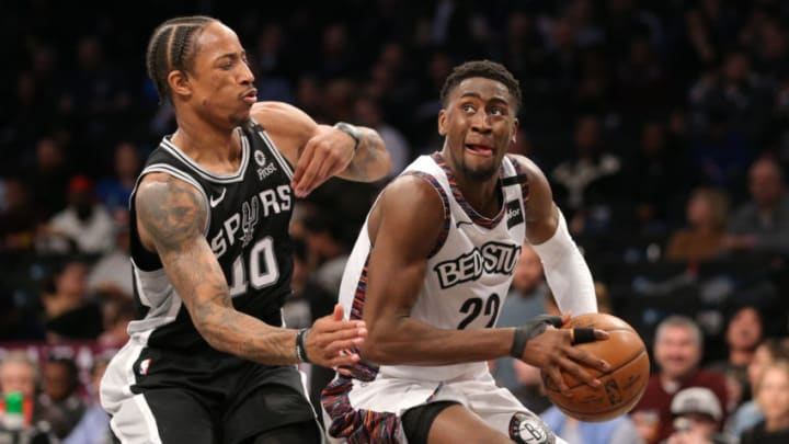 Mar 6, 2020; Brooklyn, New York, USA; Brooklyn Nets shooting guard Caris LeVert (22) controls the ball against San Antonio Spurs small forward DeMar DeRozan (10) during the third quarter at Barclays Center. Mandatory Credit: Brad Penner-USA TODAY Sports