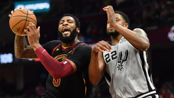 Mar 8, 2020; Cleveland, Ohio, USA; Cleveland Cavaliers center Andre Drummond (3) drives to the basket against San Antonio Spurs forward Rudy Gay (22) during the second half at Rocket Mortgage FieldHouse. Mandatory Credit: Ken Blaze-USA TODAY Sports