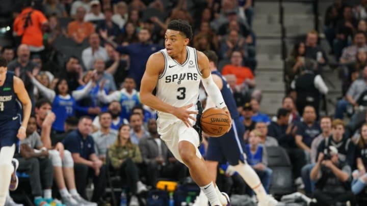Mar 10, 2020; San Antonio, Texas, USA; San Antonio Spurs forward Keldon Johnson (3) brings the ball up the court against the Dallas Mavericks in the first half at the AT&T Center. (Daniel Dunn-USA TODAY Sports)