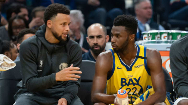 February 23, 2020; San Francisco, California, USA; Golden State Warriors guard Stephen Curry (30) talks to guard Andrew Wiggins (22) during the third quarter against the New Orleans Pelicans at Chase Center. Mandatory Credit: Kyle Terada-USA TODAY Sports