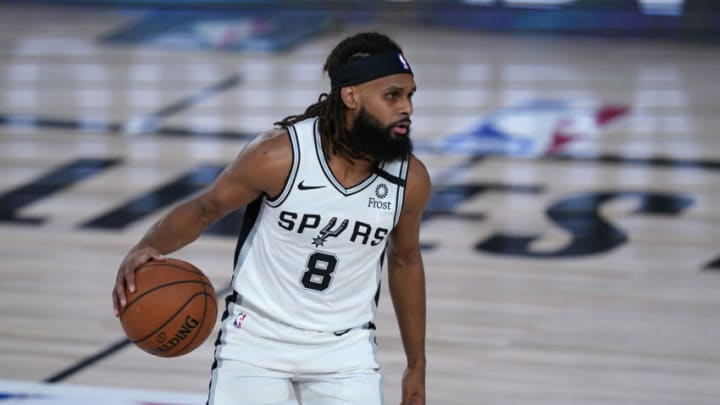 Aug 2, 2020; Lake Buena Vista, FL, USA; San Antonio Spurs' Patty Mills (8) dribbles up the court against the Memphis Grizzlies during the first half of an NBA basketball game Sunday, Aug. 2, 2020, in Lake Buena Vista, Fla. Mandatory Credit: Ashley Landis/Pool Photo via USA TODAY Sports
