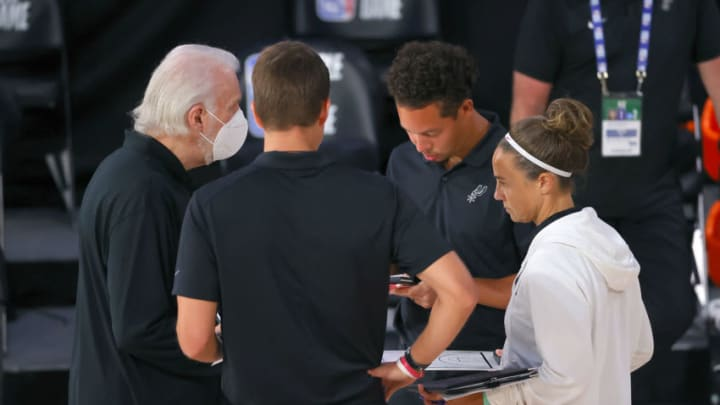 Aug 3, 2020; Lake Buena Vista, USA; Head coach Gregg Popovich of the San Antonio Spurs speaks to his staff during a timeout against the Philadelphia 76ers during the second quarter at Visa Athletic Center at ESPN Wide World Of Sports Complex on August 03, 2020 in Lake Buena Vista, Florida. Mandatory Credit: Mike Ehrmann/Pool Photo via USA TODAY Sports