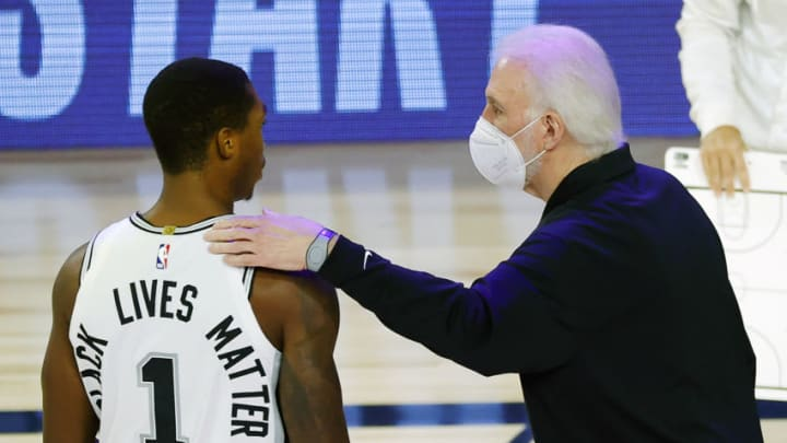 Aug 13, 2020; Lake Buena Vista, Florida, USA; Gregg Popovich of the San Antonio Spurs talks with Lonnie Walker IV #1 of the San Antonio Spurs during the first quarter against the Utah Jazz at The Field House at ESPN Wide World of Sports Complex. Mandatory Credit: Kevin C. Cox/Pool Photo-USA TODAY Sports