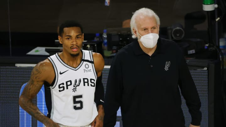 Aug 13, 2020; Lake Buena Vista, Florida, USA; Gregg Popovich of the San Antonio Spurs talks with Dejounte Murray #5 of the San Antonio Spurs during the first quarter against the Utah Jazz at The Field House at ESPN Wide World of Sports Complex. Mandatory Credit: Kevin C. Cox/Pool Photo-USA TODAY Sports