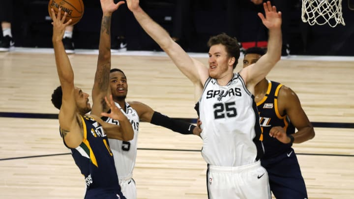 Aug 13, 2020; Lake Buena Vista, Florida, USA; Nigel Williams-Goss #0 of the Utah Jazz passes against Dejounte Murray #5 of the San Antonio Spurs and Jakob Poeltl #25 of the San Antonio Spurs during the third quarter at The Field House at ESPN Wide World of Sports Complex. (Kevin C. Cox/Pool Photo-USA TODAY Sports)