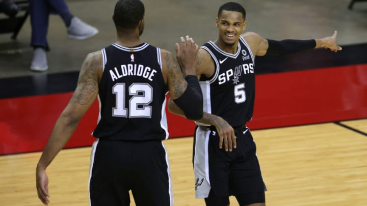 Dec 17, 2020; Houston, TX, USA; LaMarcus Aldridge #12 of the San Antonio Spurs speaks with Dejounte Murray #5 during the second quarter of a game against the Houston Rockets at the Toyota Center on December 17, 2020 in Houston, Texas. Mandatory Credit: Carmen Mandato/Pool Photo-USA TODAY Sports