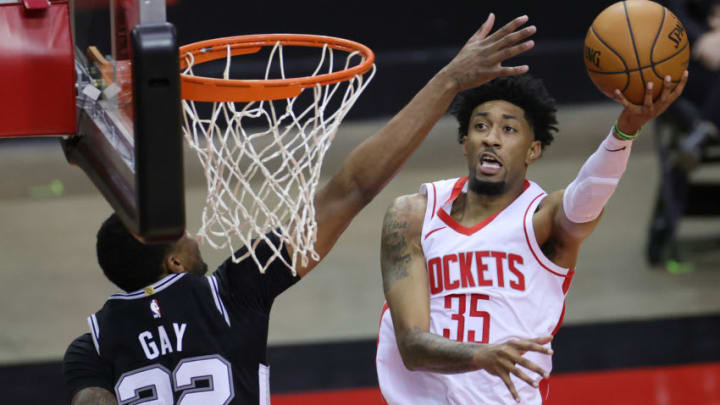 Dec 17, 2020; Houston, TX, USA; Christian Wood #35 of the Houston Rockets puts up a shot against defender Rudy Gay #22 of the San Antonio Spurs during the second quarter of a game at the Toyota Center on December 17, 2020 in Houston, Texas. Mandatory Credit: Carmen Mandato/Pool Photo-USA TODAY Sports