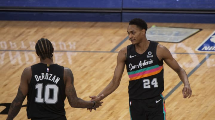 Dec 23, 2020; Memphis, Tennessee, USA; San Antonio Spurs guard DeMar DeRozan (10) and San Antonio Spurs guard Devin Vassell (24) celebrate during the second half against the Memphis Grizzlies at FedExForum. Mandatory Credit: Justin Ford-USA TODAY Sports
