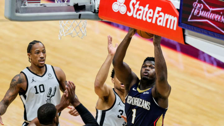 Dec 27, 2020; New Orleans, Louisiana, USA; New Orleans Pelicans forward Zion Williamson (1) drives to the basket against San Antonio Spurs guard Keldon Johnson (3) during the first half at the Smoothie King Center. Mandatory Credit: Stephen Lew-USA TODAY Sports