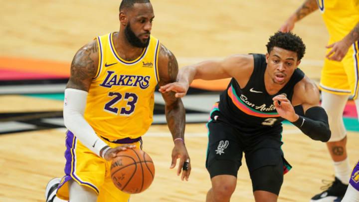 Jan 1, 2021; San Antonio, Texas, USA; Los Angeles Lakers forward LeBron James (23) drives against San Antonio Spurs guard Keldon Johnson (3) in the second half at the AT&T Center. Mandatory Credit: Daniel Dunn-USA TODAY Sports