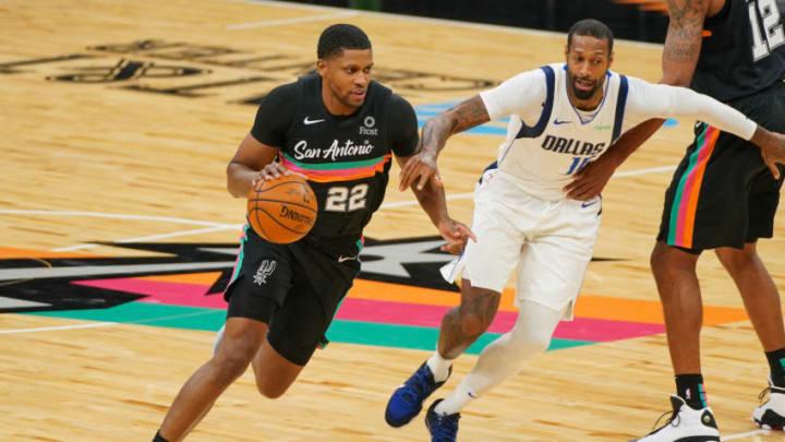 Jan 22, 2021; San Antonio, Texas, USA; San Antonio Spurs forward Rudy Gay (22) drives past Dallas Mavericks forward James Johnson (16) in the first half at the AT&T Center. Mandatory Credit: Daniel Dunn-USA TODAY Sports
