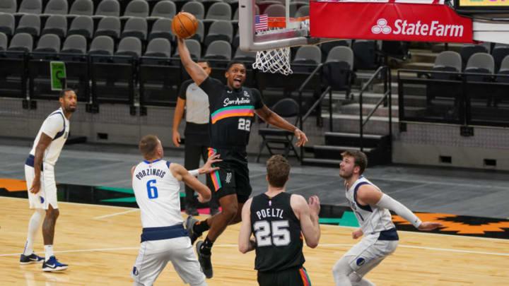 Jan 22, 2021; San Antonio, Texas, USA; San Antonio Spurs forward Rudy Gay (22) dunks in the first half against the Dallas Mavericks at the AT&T Center. Mandatory Credit: Daniel Dunn-USA TODAY Sports