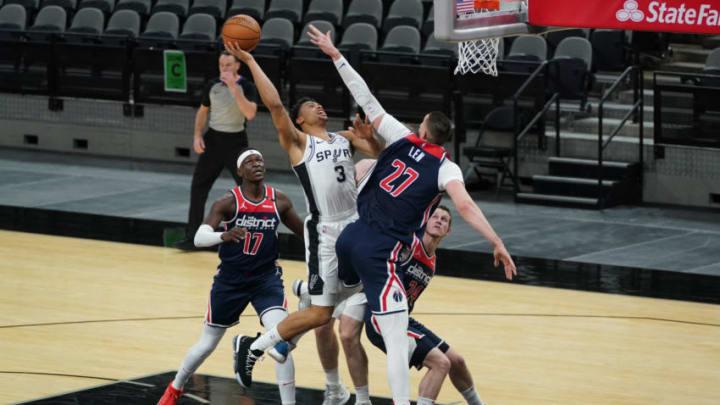 Jan 24, 2021; San Antonio, Texas, USA; San Antonio Spurs forward Keldon Johnson (3) shoots over Washington Wizards center Alex Len (27) in the first half at the AT&T Center. Mandatory Credit: Daniel Dunn-USA TODAY Sports
