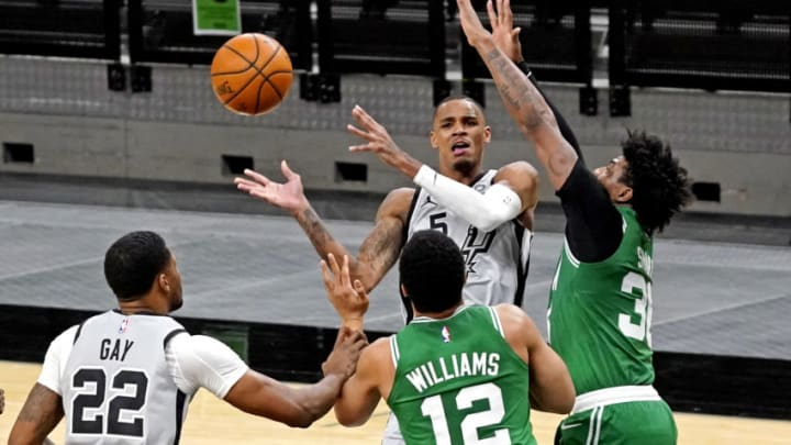 Jan 27, 2021; San Antonio, Texas, USA; San Antonio Spurs guard Dejounte Murray (5) passes the ball against Boston Celtics guard Marcus Smart (36) during the fourth quarter at AT&T Center. Mandatory Credit: Scott Wachter-USA TODAY Sports