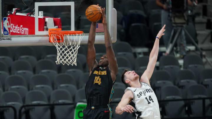 Jan 30, 2021; San Antonio, Texas, USA; Memphis Grizzlies center Gorgui Dieng (14) dunks in the second half against the San Antonio Spurs at the AT&T Center. Mandatory Credit: Daniel Dunn-USA TODAY Sports