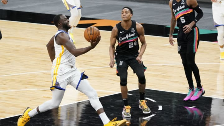 Feb 9, 2021; San Antonio, Texas, USA; Golden State Warriors forward Draymond Green (23) drives to the basket past San Antonio Spurs guard Devin Vassell (24) in the third quarter at AT&T Center. Mandatory Credit: Scott Wachter-USA TODAY Sports