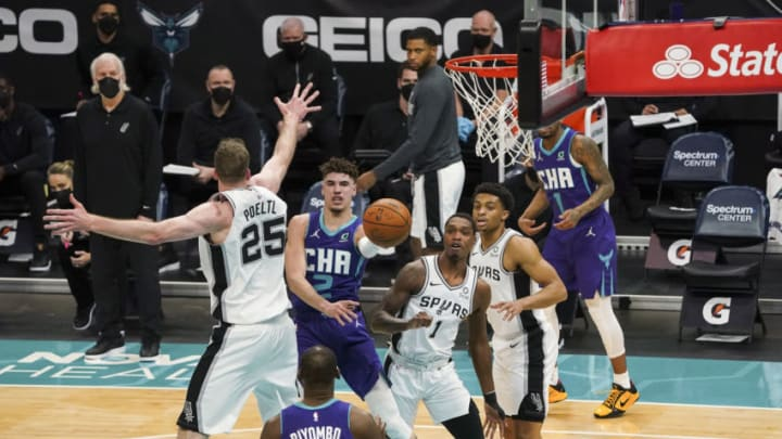 Feb 14, 2021; Charlotte, North Carolina, USA; Charlotte Hornets guard LaMelo Ball (2) passes off to center Bismack Biyombo (8) against the San Antonio Spurs during the first quarter at Spectrum Center. Mandatory Credit: Jim Dedmon-USA TODAY Sports