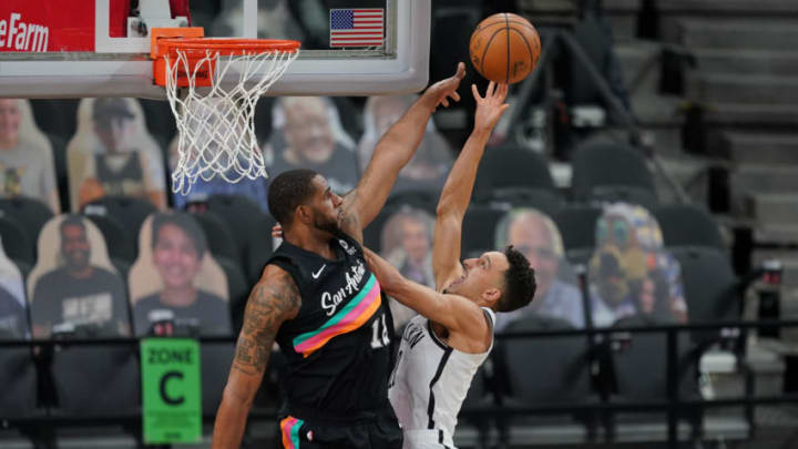 Mar 1, 2021; San Antonio, Texas, USA; Brooklyn Nets guard Landry Shamet (20) shoots over San Antonio Spurs center LaMarcus Aldridge (12) at the AT&T Center. Mandatory Credit: Daniel Dunn-USA TODAY Sports