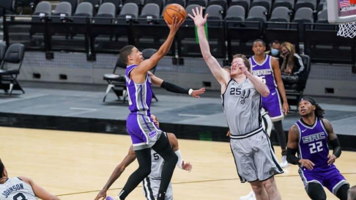 Mar 29, 2021; San Antonio, Texas, USA; Sacramento Kings guard Tyrese Haliburton (0) shoots over San Antonio Spurs center Jakob Poeltl (25) in the second half at the AT&T Center. Mandatory Credit: Daniel Dunn-USA TODAY Sports