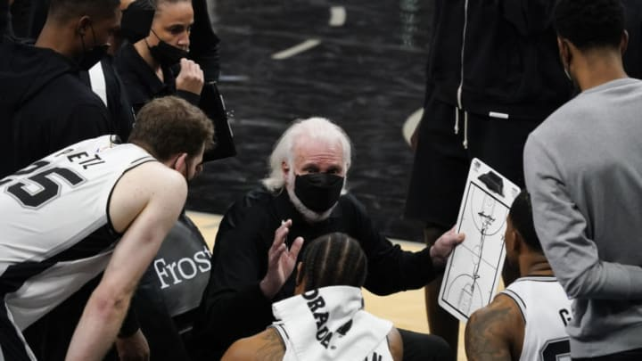 Apr 1, 2021; San Antonio, Texas, USA; San Antonio Spurs head coach Gregg Popovich talks with players during a timeout at the end of the fourth quarter against the Atlanta Hawks at AT&T Center. Mandatory Credit: Scott Wachter-USA TODAY Sports