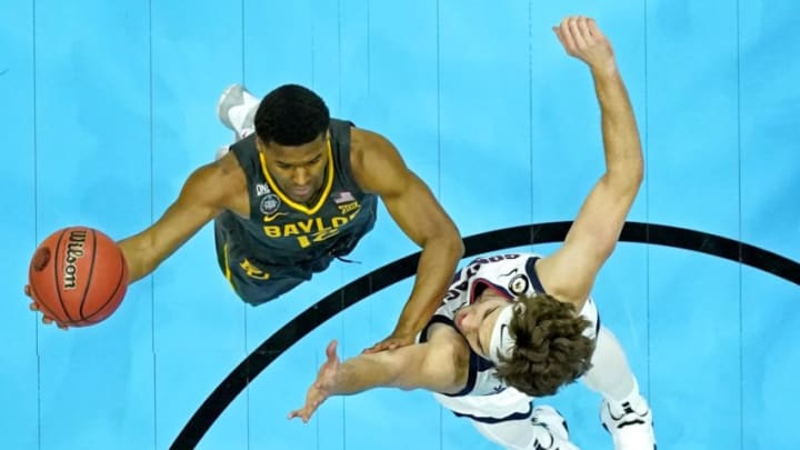 Apr 5, 2021; Indianapolis, IN, USA; Baylor Bears guard Jared Butler (12) shoots the ball the ball against Gonzaga Bulldogs forward Corey Kispert (24) during the first half in the national championship game during the Final Four of the 2021 NCAA Tournament at Lucas Oil Stadium. Mandatory Credit: Kyle Terada-USA TODAY Sports