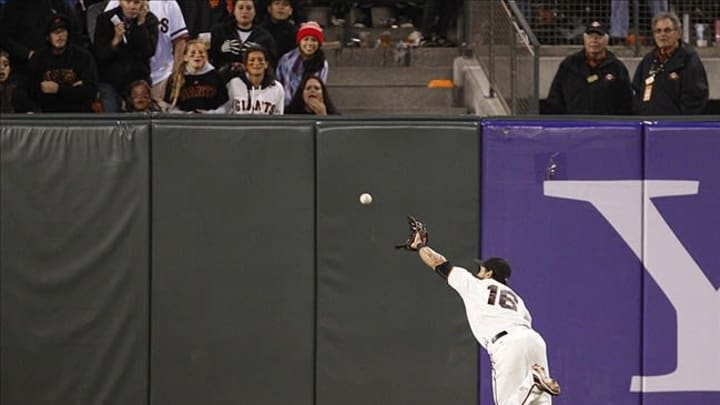 July 24, 2012; San Francisco, CA, USA; San Francisco Giants center fielder Angel Pagan (16) leaps to catch the ball to start a double play during the seventh inning at AT