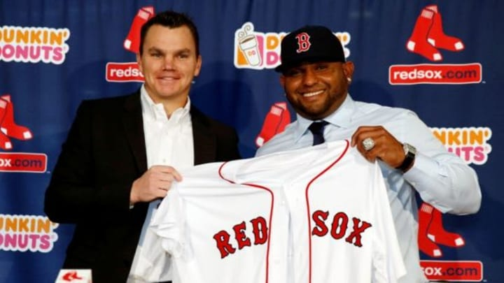 Nov 25, 2014; Boston, Ma, USA; Boston Red Sox general manager Ben Cherington (left) and third baseman Pablo Sandoval hold a jersey during the introductory press conference at Fenway Park. Mandatory Credit: Greg M. Cooper-USA TODAY Sports