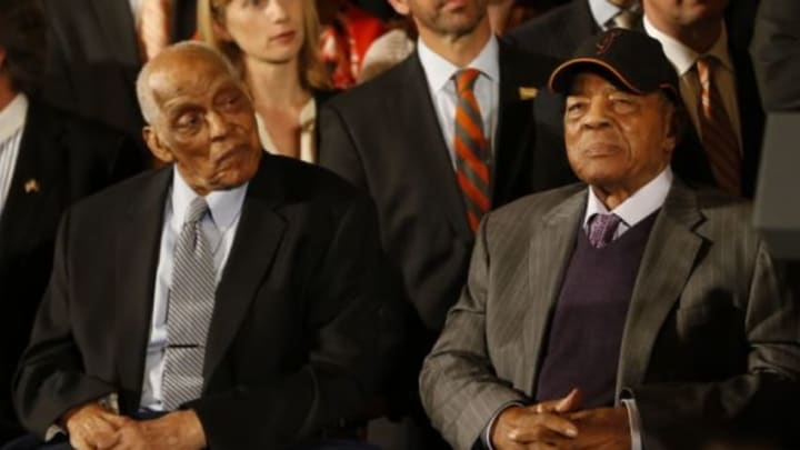 Jun 4, 2015; Washington, DC, USA; Baseball hall of famers Monte Irvin (left) and Willie Mays (right) and members of the San Francisco Giants listen during a ceremony honoring the World Series champion Giants in the East Room at the White House. Mandatory Credit: Geoff Burke-USA TODAY Sports