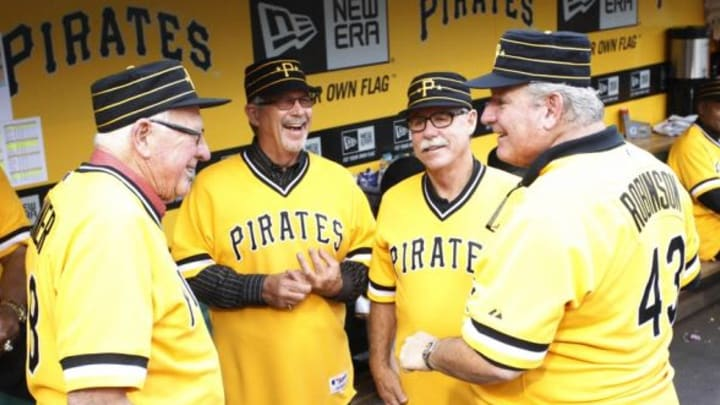 May 21, 2014; Pittsburgh, PA, USA; Members of the Pittsburgh Pirates 1979 World Series championship team Bob Skinner (L) and Tim Foli (LC) and Phil Garner (RC) and Don Robinson (43) reminisce in the dugout before the Pirates host the Baltimore Orioles at PNC Park. The Pirates won 9-8. Mandatory Credit: Charles LeClaire-USA TODAY Sports